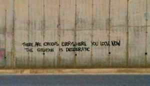 "Statement on wall: ""There are crooks everywhere you look. Now the situation is desperate""."